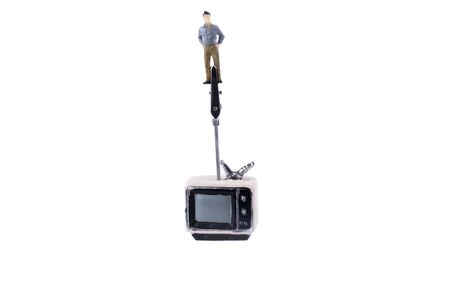 retro styled: Man standing on the top of a retro styled television set on a white background