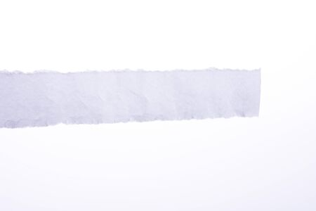 information medium: a piece of white blank torn note paper