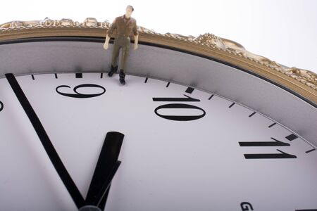 conceptional: model man in a clock on a white background
