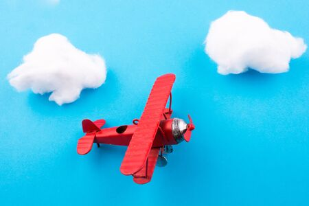 model airplane: Retro styled little red model airplane in sky