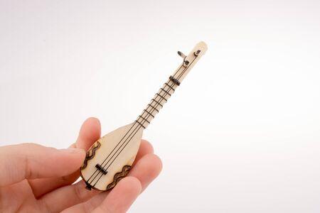 saz: Hand holding the classic turkish instrument Saz Stock Photo