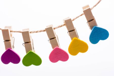 Hearted clips hanging on a thin rope