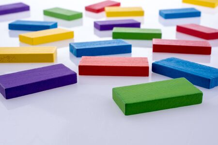 the collapsing: Color dominoes on a white background