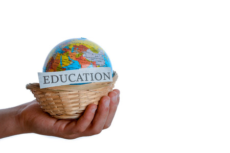 one hand: education in one hand and globe in one hand in a basket Stock Photo