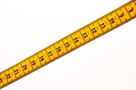 Yellow color Tape measure roll  on a white background