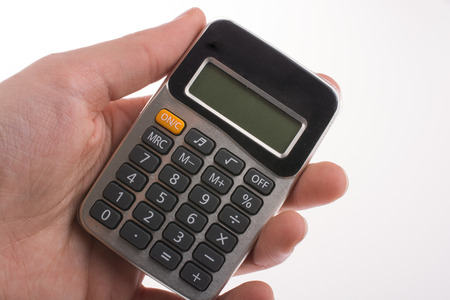 subtract: Hand holding a  calculator on a white background Stock Photo