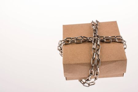 Cardboard Box in chains on a white background