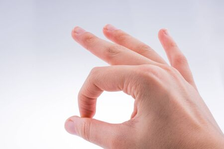 gesturing: Gesturing Ok With Two Fingers