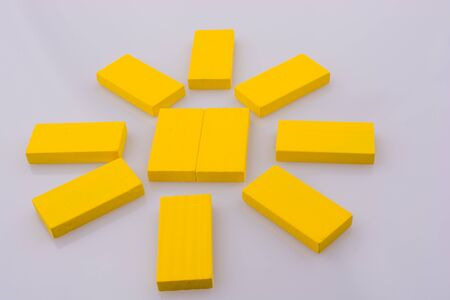 Color Dominoes making a sun on a white background