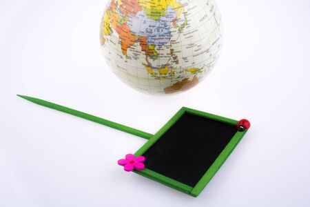 educational tools: Globe and signboard on a white background Stock Photo