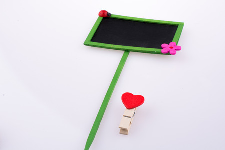 hearted: Red hearted clip near a small board
