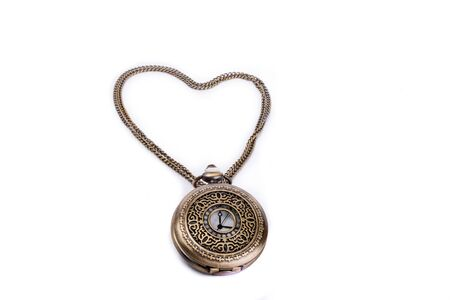 retro styled: Retro styled pocket watch and its chain form a heart on a white background