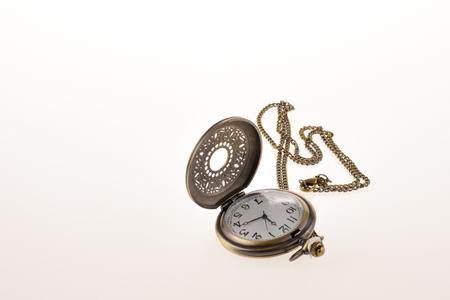 retro styled: Isolated retro styled pocket watch on white background