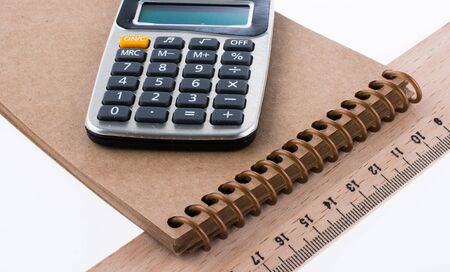 centimetre: Calculator, ruler, notebook on white background
