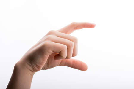 pinching: Hand measuring on a white background Stock Photo