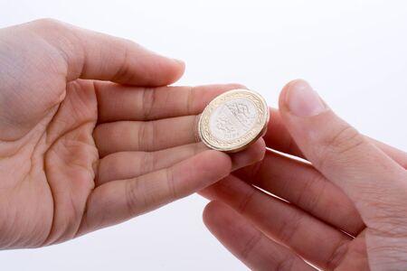 turkish lira: Turkish coin  one Turkish Lira in hand