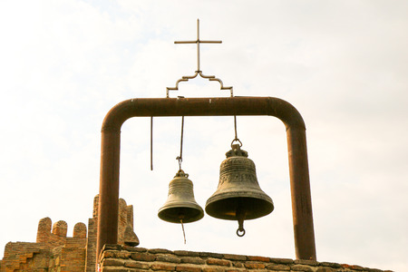 Old twin traditional metal church bells Stock Photo