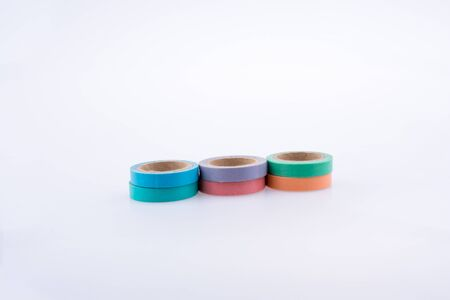 insulating: colorful insulating adhesive tapes on white background