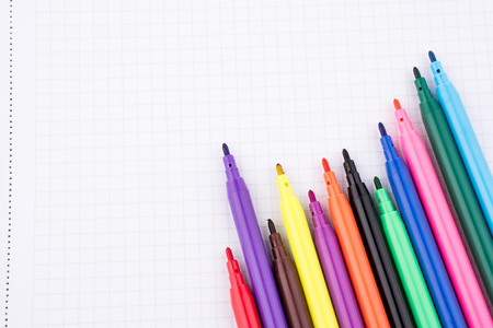 Colorful felt-tip pens on a notebook Stock Photo