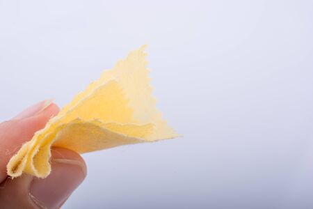 handkerchief: Yellow color mini handkerchief in hand on white background Stock Photo