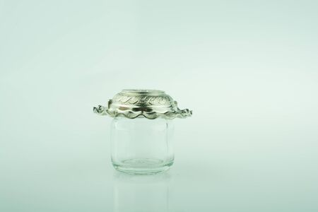 empty jar: Plate covers the top of a little empty jar  on a colorful background Stock Photo