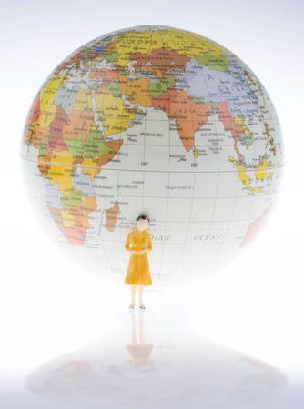 ittle: ittle model globe by the side of  woman figure Stock Photo