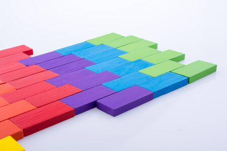Colorful Domino Blocks on a white background Stock Photo