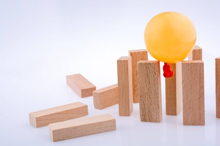 Balloon and  domino  pieces positioned on white background Stock Photo