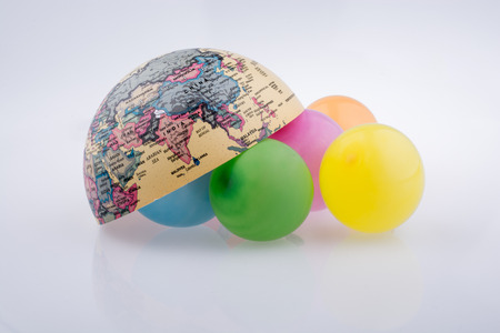 Color balloons are placed around the half a globe