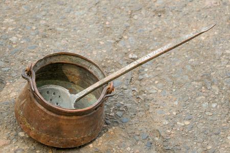 cooking utensil: Selling old metal  cookware in bazaar