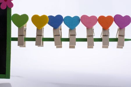 dearest: Colorful clothespin attached attached on a line side by side Stock Photo