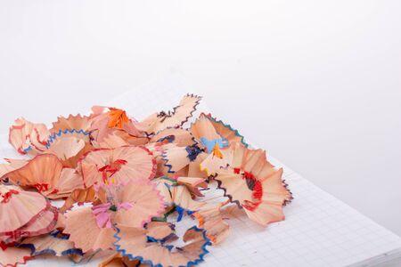 sharpenings: Shavings of color pencils on white background