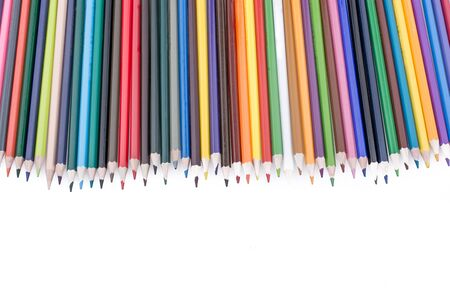 Color Pencils  of various colors on a  white background
