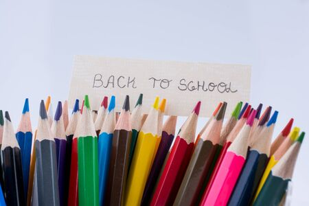 Color Pencils and back to school title on a  white background