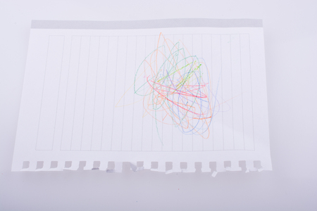 scrawl: Blank lined paper scribbled with color pencils Stock Photo
