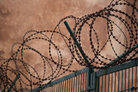 barbed wire fence  used for protection purposes of a pproperty Stock Photo