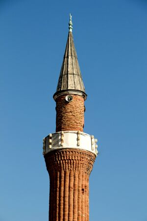 minaret: Minaret made of  stone in Ottoman time Mosques in view Stock Photo