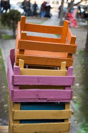 Colorful wooden empty crate boxes for sale in a market place