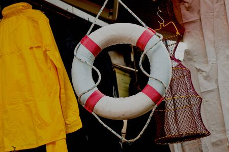 Lifesaver or life preserver with rope around for a drowning person to grab