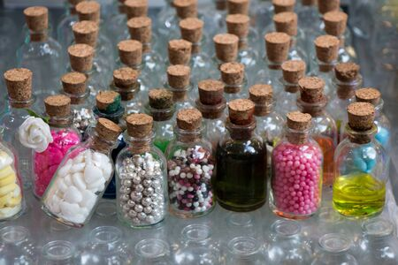 Set of Empty small transparent bottles filled with beads
