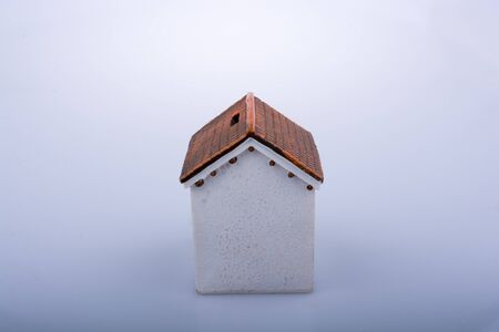 Little model house  on a light  brown color background Stock Photo