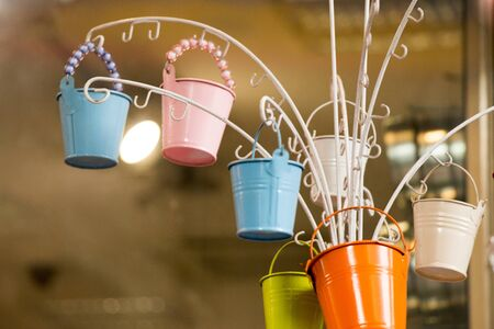 galvanized: Little set of buckets of various colors in a market place