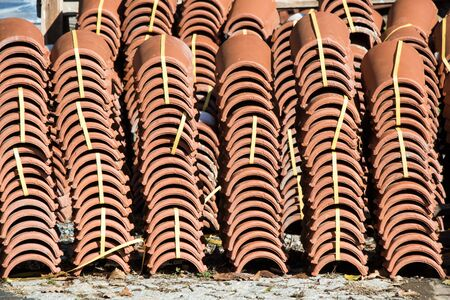 Pile of  roofing tiles as a construction material at a building suppliers Stock Photo