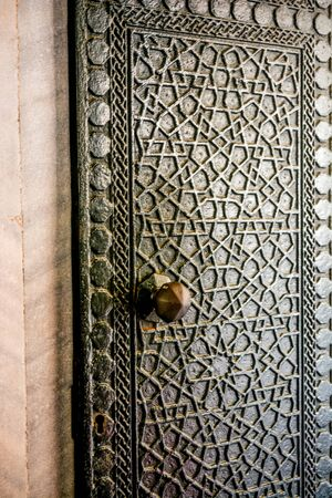 Ottoman styled geometric patterns on  metal doors