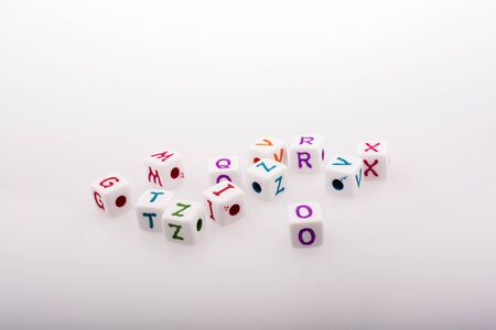 Colorful alphabet letter cubes on a white background Stock Photo