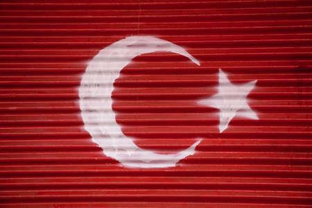 turkiye: Turkish national  flag painted on metal background in the street Stock Photo
