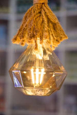 chandelier background: Decorative antique edison style filament light bulbs hanging
