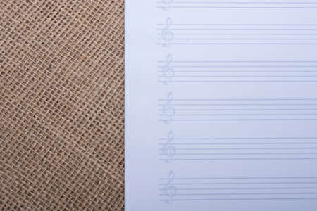 business backgound: An empty white note paper for musical notes