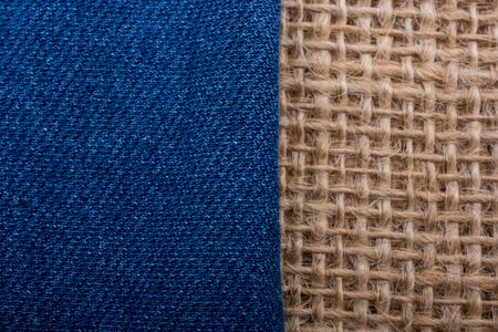 business backgound: Denim canvas placed on  linen canvas as  a background