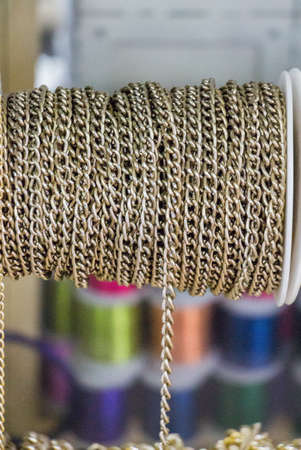 Rolls of decorative chains in view Stock Photo